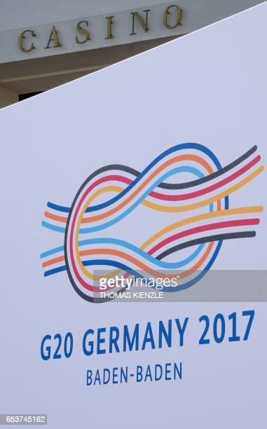 The G20 logo is displayed in front of the Casino and the Kurhaus in BadenBaden southern Germany on March 16 one day before the gathering of G20...