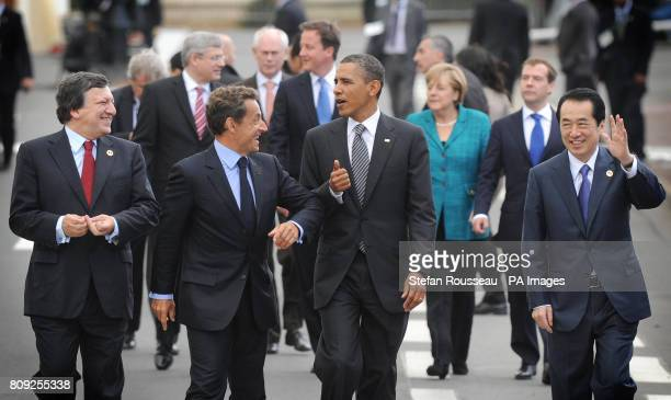 The G8 leaders including President of the European Commission Jose Maneul Barroso French President Nicolas Sarkozy US President Barack Obama and...