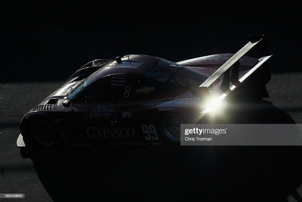 The #99 Gainsco/Bob Stallings Racing Gainsco Auto Insurance Corvette DP driven by Jon Fogarty, Alex Gurney, Memo Gidley and Darrel Law, races during the Rolex 24 at Daytona International Speedway on January 27, 2013 in Daytona Beach, Florida.