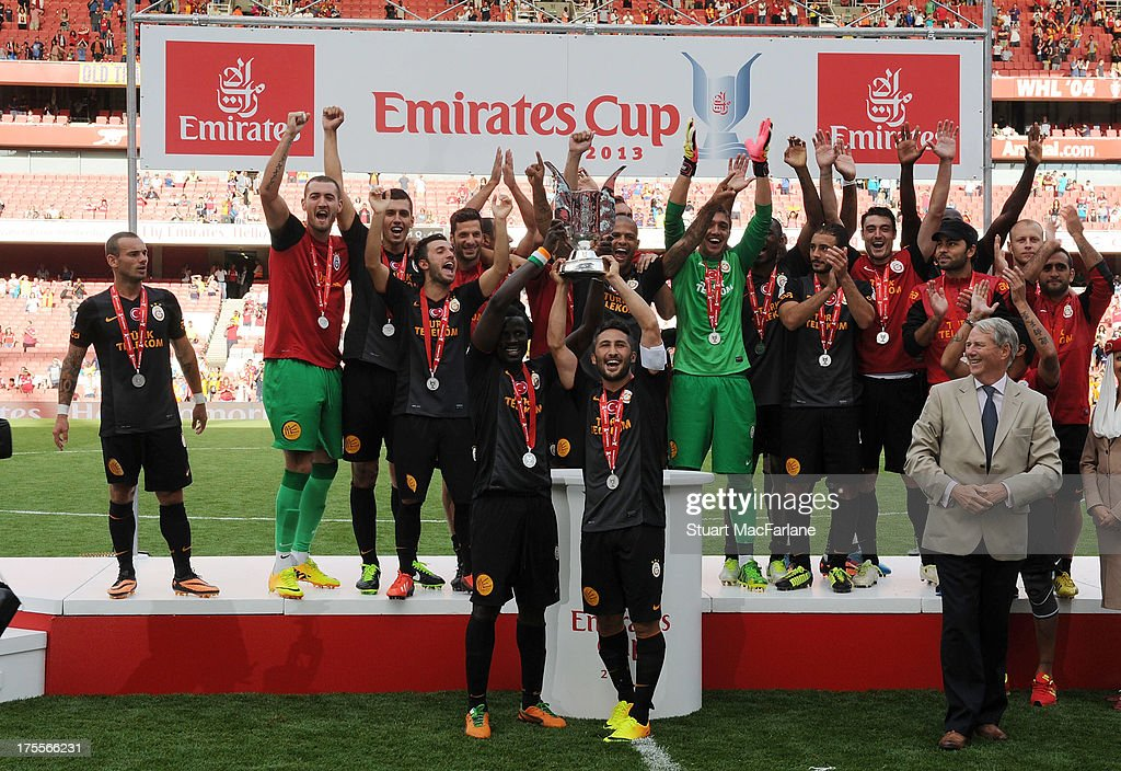 The Galatasaray team lift the Emirates Cup match between Arsenal and Galatasaray at the Emirates Stadium on August 04, 2013 in London, England.