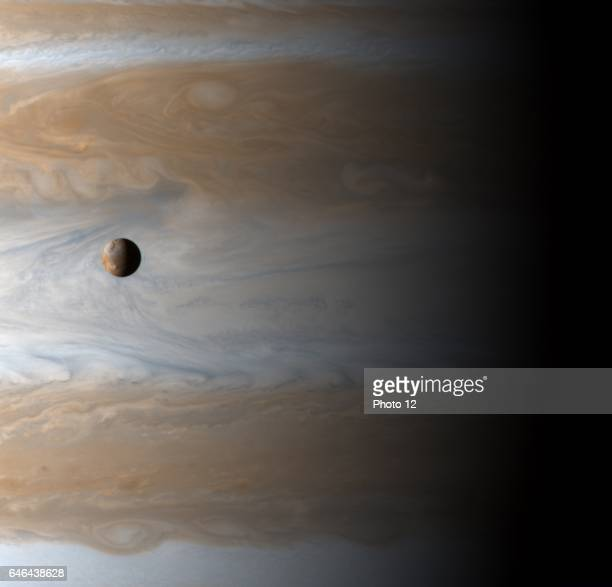 The Galilean satellite Io floats above the cloudtops of Jupiter in this image captured on January 1 2001 Cassini Spacecraft