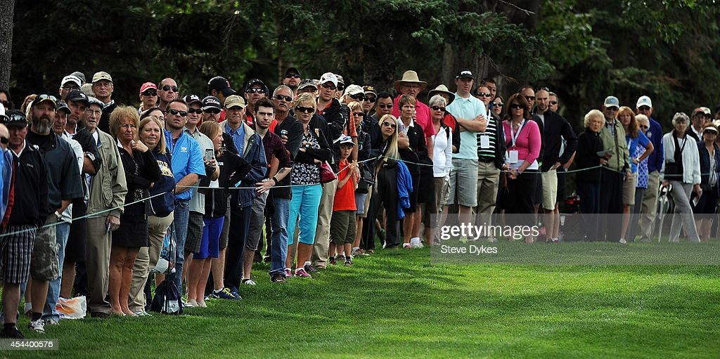The gallery lines the fairway on the 10th hole during the second round of the Shaw Charity Classic at the Canyon Meadows Golf and Country Club on August 30, 2014 in Calgary, Canada.