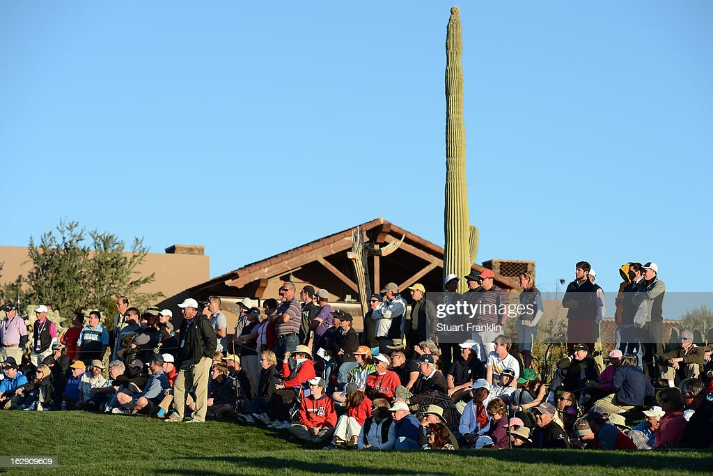 The Gallery of fans watches play on the 18th hole green during the quarterfinal round of the World Golf Championships - Accenture Match Play at the Golf Club at Dove Mountain on February 23, 2013 in Marana, Arizona.