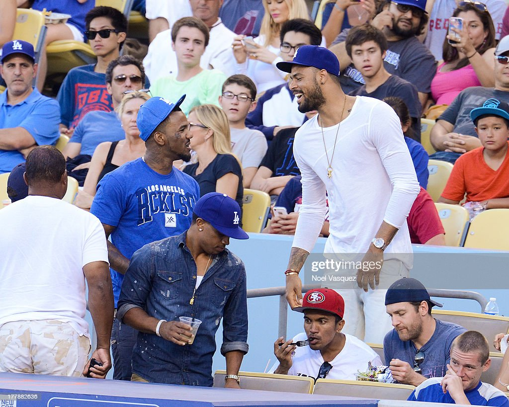 The Game and <a gi-track='captionPersonalityLinkClicked' href=/galleries/search?phrase=Tyson+Chandler&family=editorial&specificpeople=202061 ng-click='$event.stopPropagation()'>Tyson Chandler</a> attends a baseball game between the Boston Red Sox and the Los Angeles Dodgers at Dodger Stadium on August 25, 2013 in Los Angeles, California.