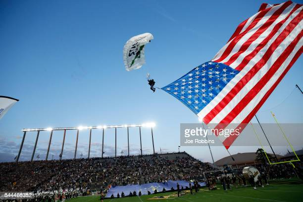 The game ball is delivered via sky diver under new lights for the Purdue Boilermakers prior to a game against the Ohio Bobcats at RossAde Stadium on...