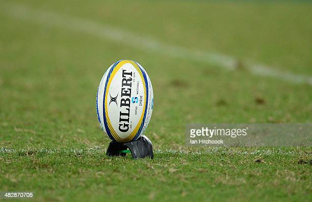 The game ball is seen sitting on a tee during the round eight Super Rugby match between the Reds and the Force at Suncorp Stadium on April 5 2014 in...