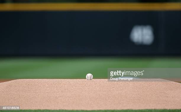 The game ball sits atop the pitcher's mound as the Milwaukee Brewers prepare to face the Colorado Rockies at Coors Field on June 21 2014 in Denver...