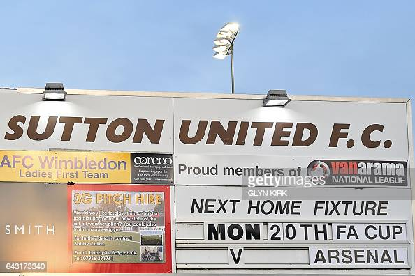 The game is announced outside the stadium ahead of the English FA Cup fifth round football match between Sutton United and Arsenal at the Borough...