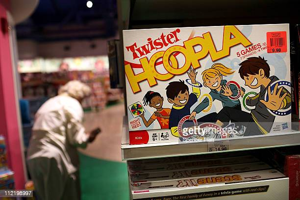 The game Twister Hoopla by toymaker Hasbro is displayed at a toy store on April 14 2011 in New York City As demand for board games and puzzles...