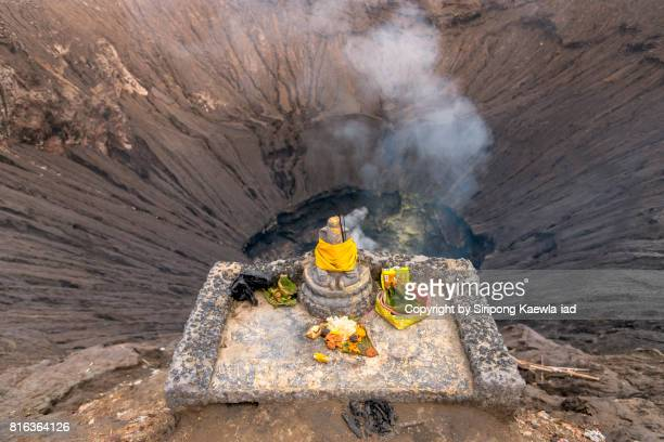 The Ganesha statue with offering food in front of the Mount Bromo crater, East Java, Indonesia.