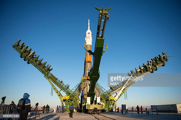 The gantry arms close around the Soyuz TMA15M spacecraft to secure the rocket at the launch pad at the Baikonur Cosmodrome on November 21 2014 in...