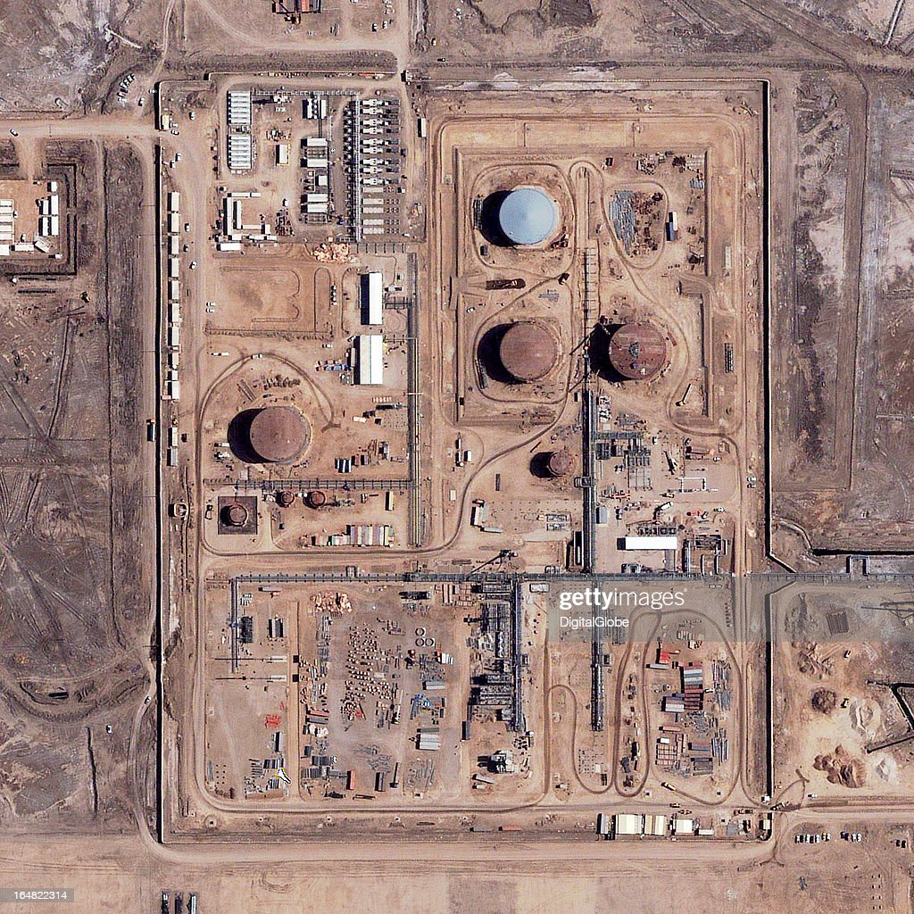 The Garraf Oil Field is located near Ar Rifā'ī in Dhī Qār Province, approximately 230 kilometers southeast of Iraq's capital, Baghdād. It is known to be Iraq's fifth largest oil field, with an estimated reserve of up to 1 billion barrels. According to reports, production was scheduled to start in late 2012 but was delayed because of infrastructure issues. This March 16, 2013, image provides an overview of the processing and storage facilities at the oil field.