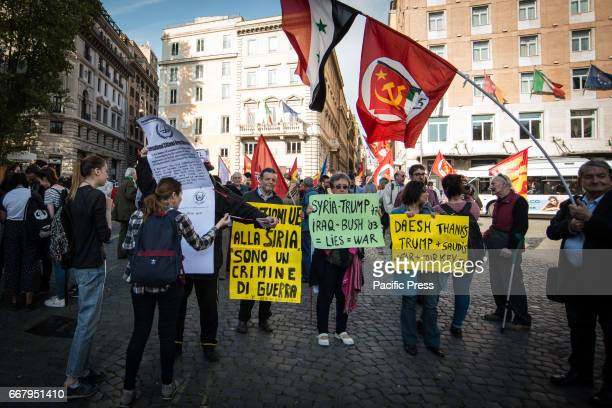 The garrison 'No War' against the war in Syria and the risk of military escalation in Korea placards against the American president Donald Trump