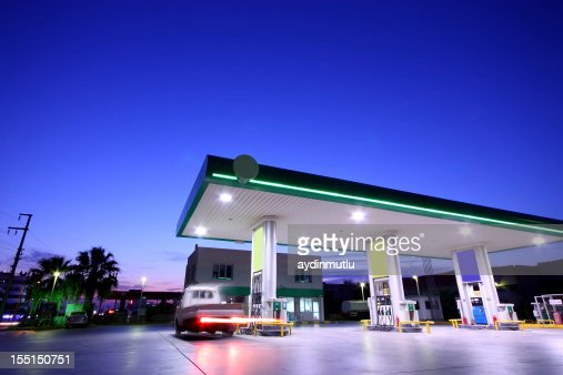 The gas station is well lit at night