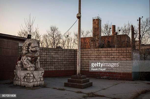 The gate of the abandoned Qingquan Steel plant which closed in 2014 and became one of several socalled 'zombie factories' on January 26 2016 in...