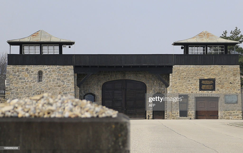 The gate with watch tower is seen inside of the World War II concentration camp of Mauthausen, on April 17, 2013. AFP PHOTO / ALEXANDER KLEIN