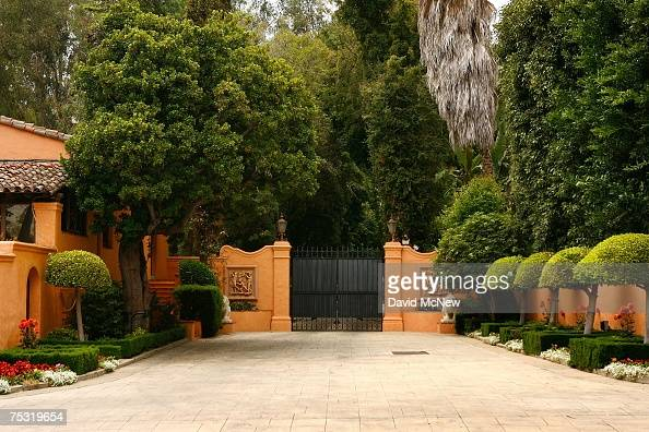 The gated entrance is closed to the Beverly House mansion of William Randolph Hearst and Marion Davies after the residence was put on the market this...