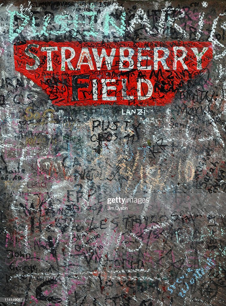The gatepost of the former Salvation Army orphanage Strawberry Field, immortalised by the Beatles song 'Strawberry Fields Forever', where John Lennon used to play as a child, in Woolton on March 19, 2011 in Liverpool, England. It was reported on May 10, 2011 that the famous red Victorian gates, which have stood on the site for 100 years, have been removed by the Salvation Army and put into storage, replaced by replicas. Many thousands of Beatles fans visit the site, a popular stop on the city's Magical Mystery Tour.
