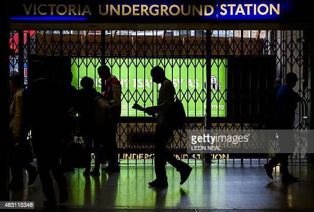 The gates at Victoria underground station are shut as a 24 hour tube strike hits London at Victoria station central London on August 6 2015 The...