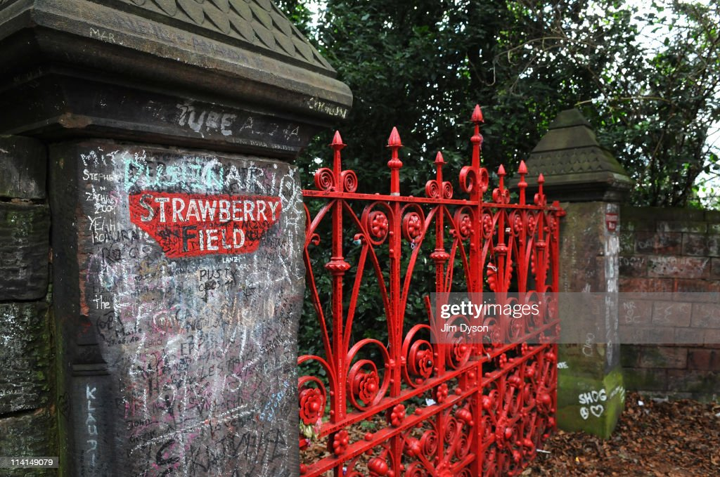 The gates of the former Salvation Army orphanage Strawberry Field, immortalised by the Beatles song 'Strawberry Fields Forever', where John Lennon used to play as a child, in Woolton on March 19, 2011 in Liverpool, England. It was reported on May 10, 2011 that the famous red Victorian gates, which have stood on the site for 100 years, have been removed by the Salvation Army and put into storage, replaced by replicas. Many thousands of Beatles fans visit the site, a popular stop on the city's Magical Mystery Tour.