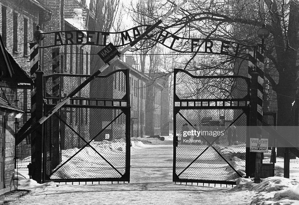 The gates of the Nazi concentration camp at Auschwitz, Poland, circa 1965. The sign above them is 'Arbeit Macht Frei' - 'Work Makes You Free'.