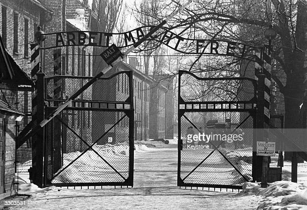 The gates of the Nazi concentration camp at Auschwitz Poland circa 1965 The sign above them is 'Arbeit Macht Frei' 'Work Makes You Free'