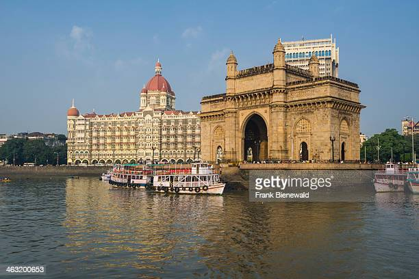 The Gateway of India in the suburb Colaba with the Taj Mahal Palace Hotel behind it seen from a ferryboat across the bay