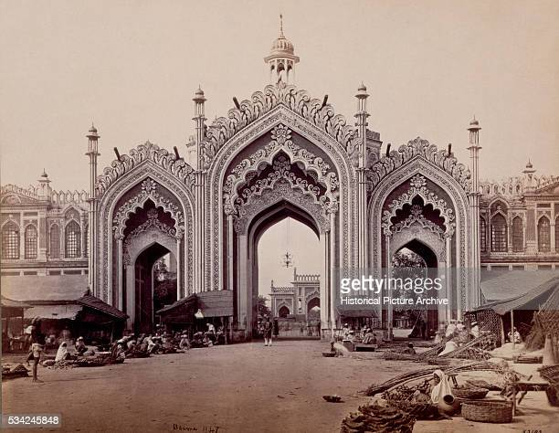 The gateway of the Hoospinbad Bazaar in Lucknow India photographed by Samuel Bourne