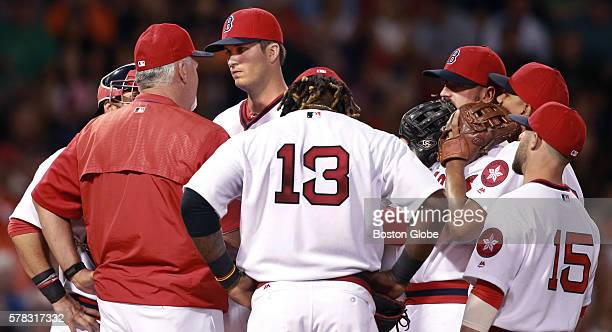 The gathering on the mound is not a happy occasion as Red Sox starting pitcher Drew Pomeranz gets a visit from pitching coach Carl Willis during the...