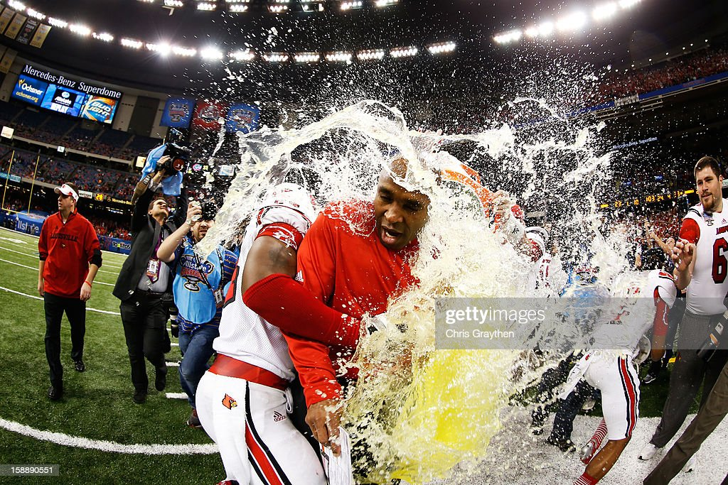The Gatorade bucket is dumped on head coach Charlie Strong of the Louisville Cardinals after their 33 to 23 win over the Florida Gators in the Allstate Sugar Bowl at Mercedes-Benz Superdome on January 2, 2013 in New Orleans, Louisiana.