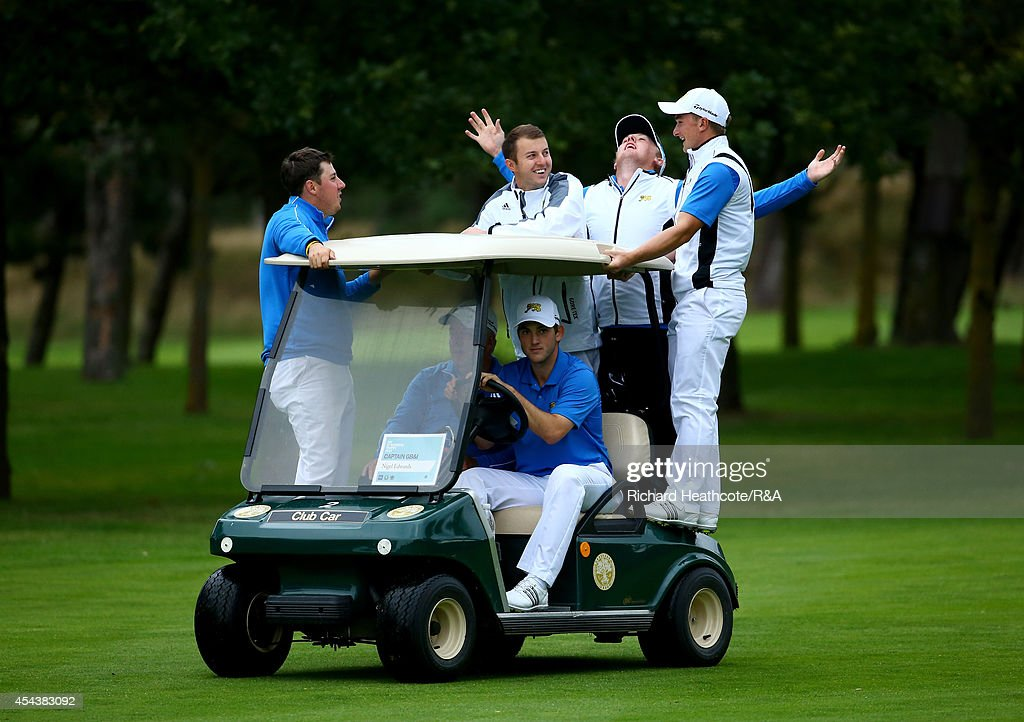The GB&I players ride a golf cart as they follow the last match during the final day of the St Andrews Trophy at Barseback Golf & Country Club on August 30, 2014 in Loddekopinge, Sweden.