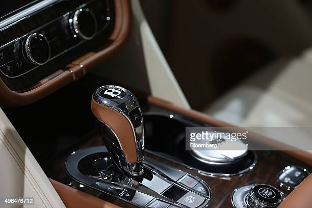The gear stick and central console of a Bentley Bentayaga SUV automobile manufactured by Bentley Motors Ltd the luxury unit of Volkswagen AG sits on...