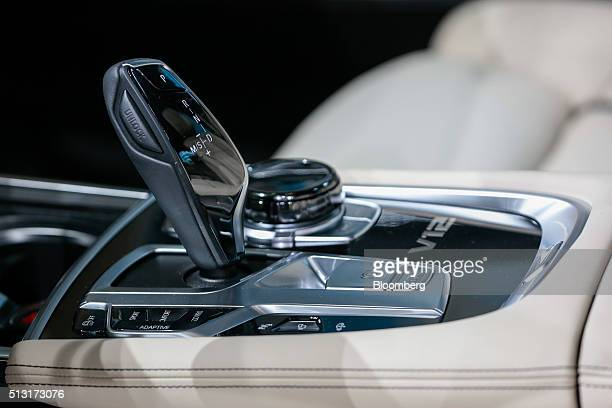 The gear stick of a BMW M760Li xDrive V12 automobile produced by Bayerische Motoren Werke AG sits on display on the first day of the 86th Geneva...