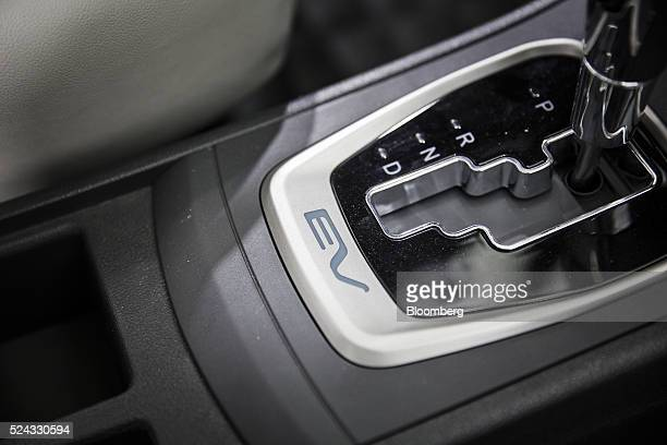 The gear stick of a Dongfeng Motor Group Co S50 electric vehicle is seen at the Beijing International Automotive Exhibition in Beijing China on...