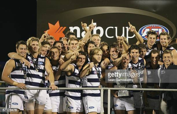 The Geelong team celebrate after winning the NAB Cup Grand Final between the Adelaide Crows and Geelong Cats at Adelaide Oval March 18 2006 in...