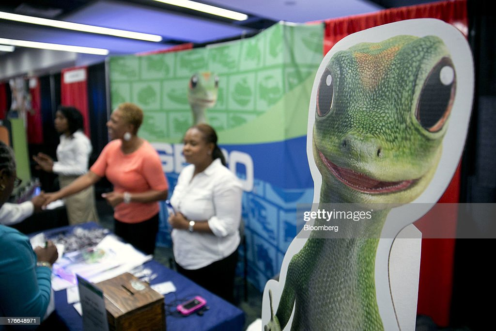 The Geico Corp. gecko mascot stands at the company's booth at the Black Data Processing Associates (BDPA) career fair in Washington, D.C., U.S., on Friday, Aug. 16, 2013. The U.S. Department of Labor is scheduled to release initial jobless claims on Aug. 22. Photographer: Andrew Harrer/Bloomberg via Getty Images