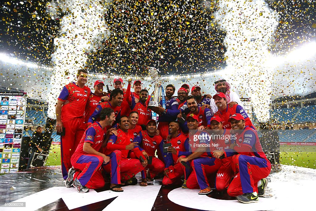 The Gemini Arabians players and staff celebrate with the trophy following their victory at the end of the Final match of the Oxigen Masters Champions League between Gemini Arabians and Leo Lions at the Dubai International Cricket Stadium on February 13, 2016 in Dubai, United Arab Emirates.