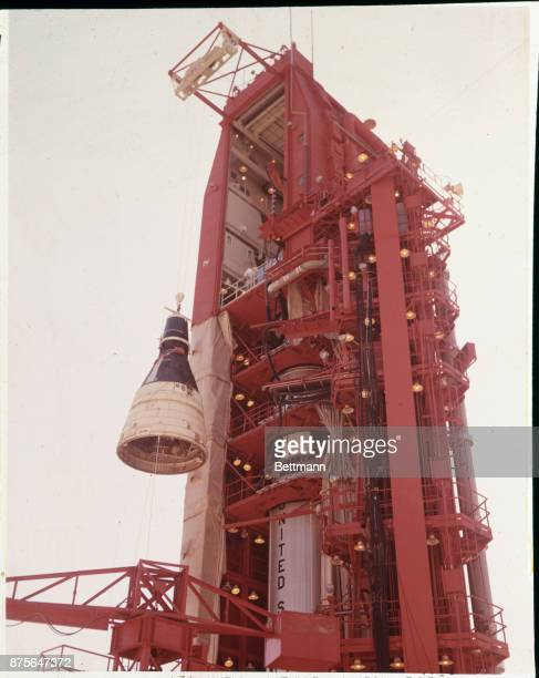 The Gemini II spacecraft weighing approximately 6900 pounds is hoisted to be mated to the Titan 2 launch vehicle at Complex 19 The flight designated...