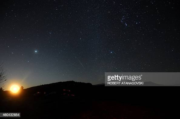 The Geminid meteor shower is seen while the moon rises late on December 13 2014 above Skopje Macedonia There are three major meteor showers during a...