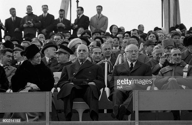 The General de Gaulle and his wife sat in debates look at the opening ceremony of Winter Olympics in Grenoble together with officials