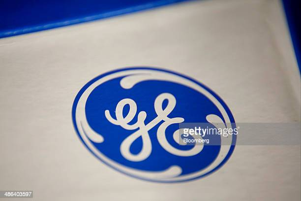 The General Electric Co logo is seen on a microwave oven displayed for sale at a Lowe's Cos store in Torrance California US on Thursday Oct 17 2013...