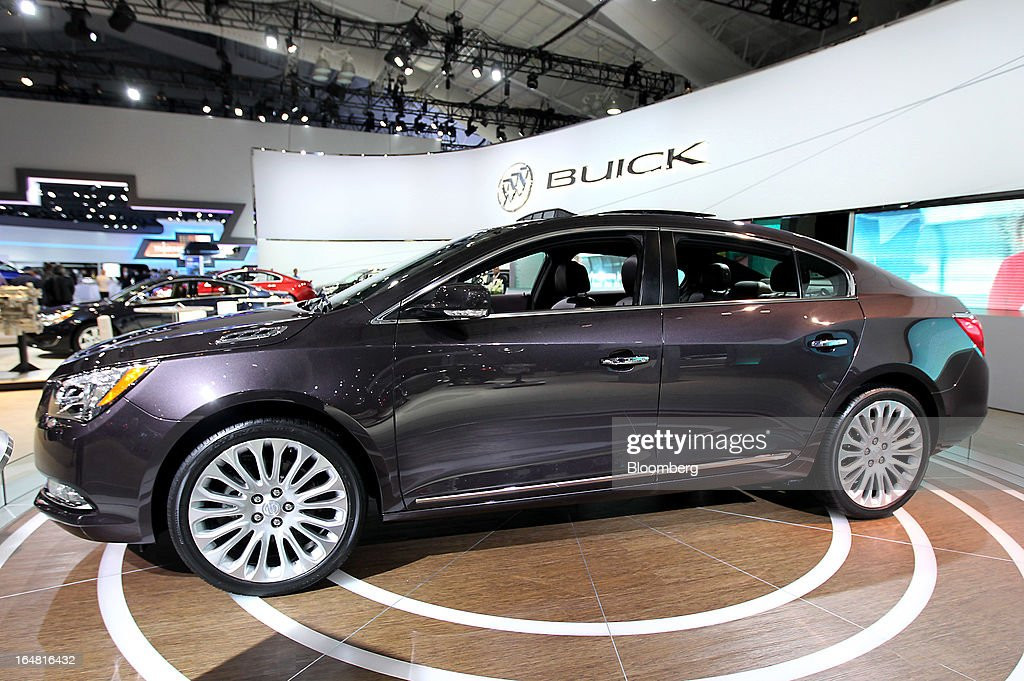 The General Motors Co. (GM) Buick 2014 Lacrosse sits on display at the company's booth during the 2013 New York International Auto Show in New York, U.S., on Thursday, March 28, 2013. The 113th New York International Auto Show, which runs from March 29 to April 7, features 1,000 vehicles as well the latest in tech, safety and innovation. Photographer: Jin Lee/Bloomberg via Getty Images