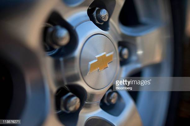 The General Motors Co Chevrolet logo is displayed on the hubcap of Volt vehicle at Stewart Chevrolet car dealership in Colma California US on Monday...