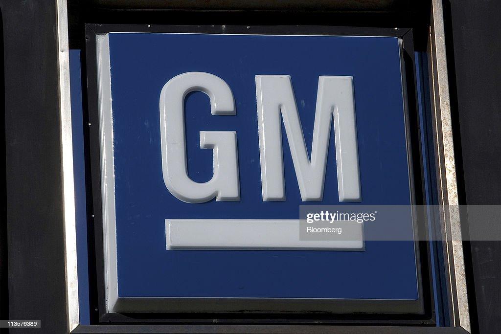 The General Motors logo is displayed at Stewart Chevrolet car dealership in Colma California US on Monday May 2 2011 General Motors Co said US sales...