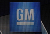 The General Motors logo is seen on a sign at their headquarters in the Renaissance Center on January 14 2014 in Detroit as previews continue at the...