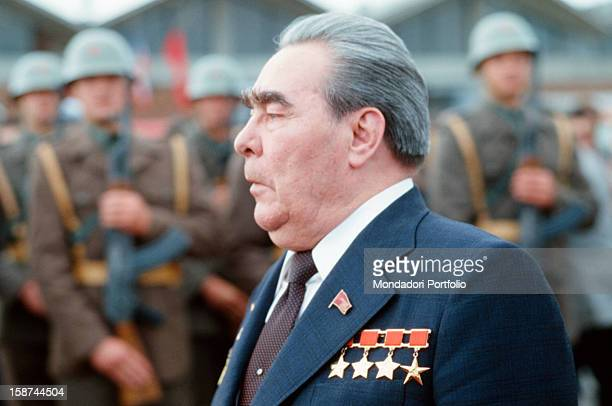 The General Secretary of the Central Committee of the Communist Party of the Soviet Union Leonid Ilyich Brezhnev walks in front of a group of...