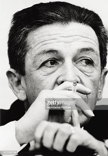 The General Secretary of the Italian Communist Party Enrico Berlinguer smoking a cigarette 1970s
