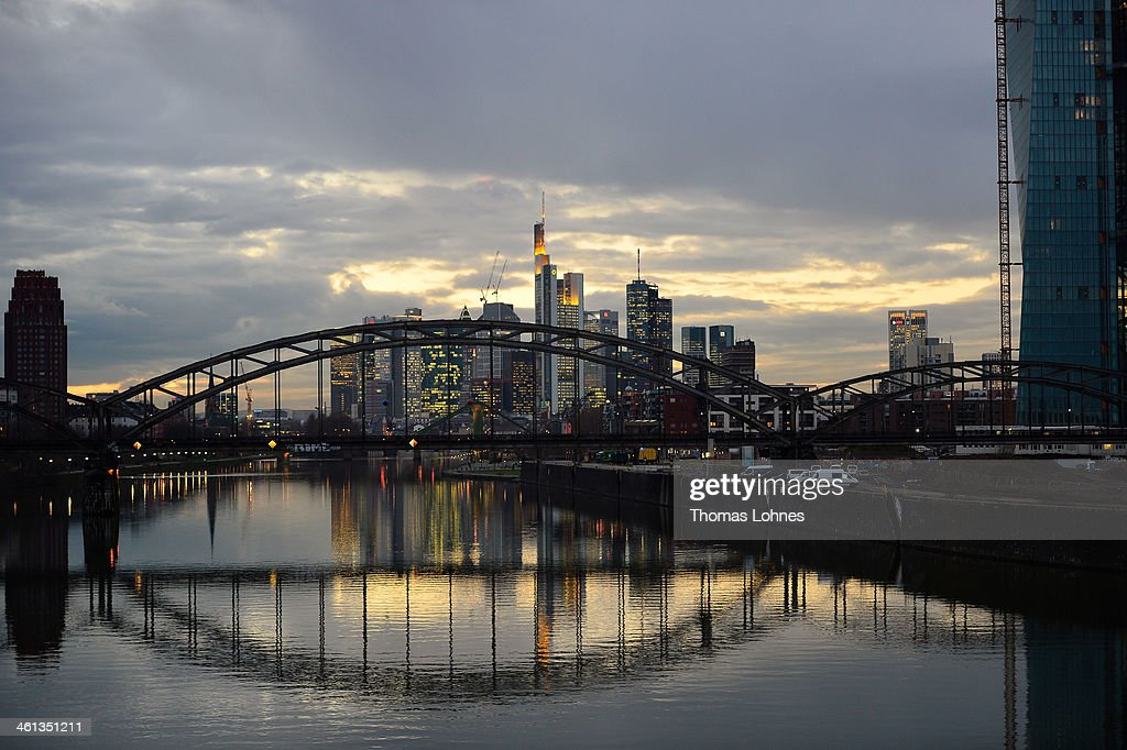 The General view from the eastside to the skyline of Frankfurt with the skycrapers illuminated in the twilight on January 07, 2014 in Frankfurt am Main, Germany. Many skycrapers in the financial district belong to leading European banks.