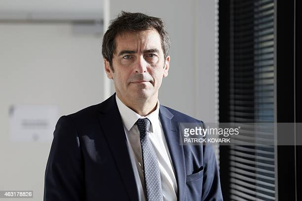 The generaldirector of the French state employment agency Pole Emploi Jean Basseres pose before giving a press conference on February 11 2015 in...