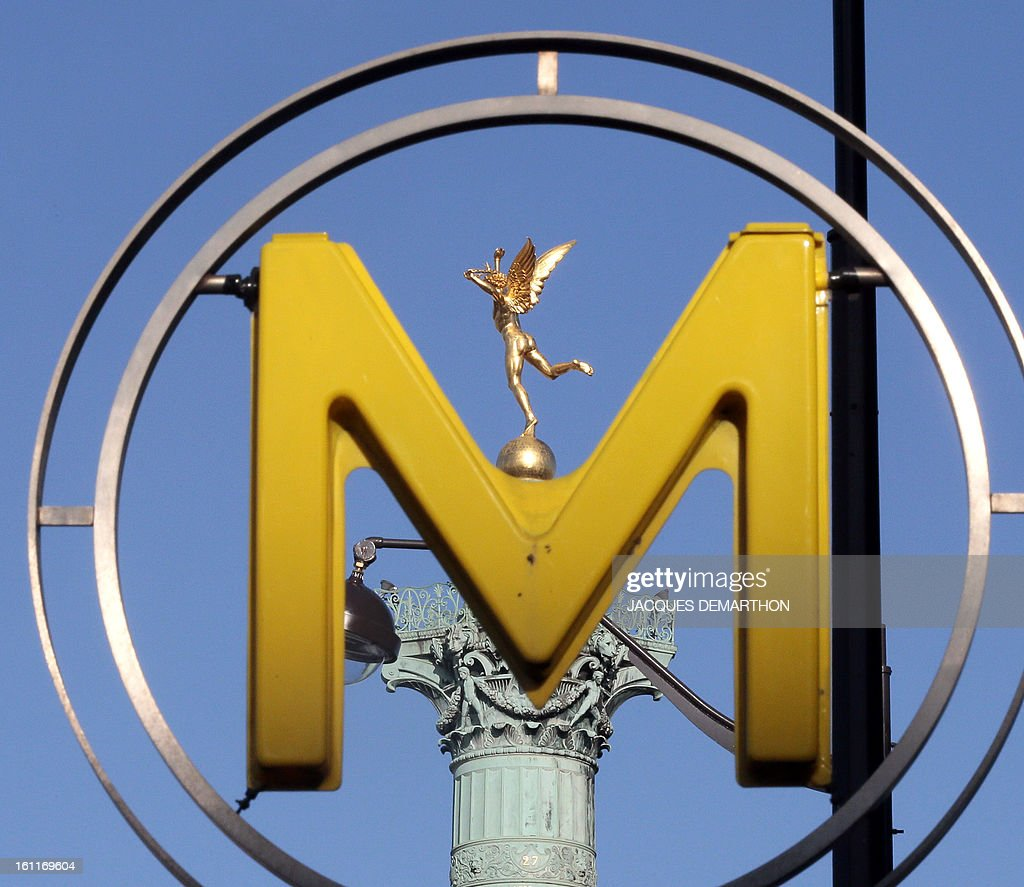 The 'genie de la Bastille' statue, situated ontop of a column in Paris' Bastille square, is pictured through a Metro sign on February 8, 2013 in Paris. AFP PHOTO / JACQUES DEMARTHON